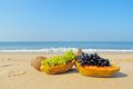 Fruits on the sand Stock Images