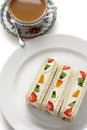 Fruits sandwich and a cup of tea Royalty Free Stock Photos