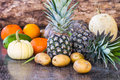 Fruits still life of on wooden background Stock Photo