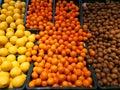 Fruits in supermarket - kiwis, oranges and grapefruits Royalty Free Stock Photo