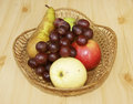 Fruits on table in basket fresh braided Stock Image