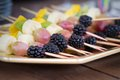 Fruits on a toothpick grapes blackberries banana Royalty Free Stock Images