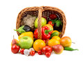 Fruits and vegetables in a basket on white background Royalty Free Stock Photography