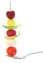 Fruits and vegetables fresh mixed on a fork Royalty Free Stock Photography