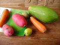 Colorful carrot, lemon, red skin radish and melon Royalty Free Stock Photo