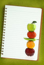Fruits vegetables painting blank notebook page Royalty Free Stock Photography