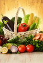 Fruits and vegetables in wicker basket Stock Photo