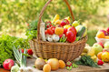 Fruits and vegetables wicker basket is full with Royalty Free Stock Image