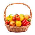 Fruits and vegetables in a wicker basket on white background Stock Photo