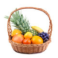 Fruits in a wicker basket on white background Stock Image