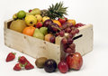 Fruits in woodden crate isolated on white backdrop Stock Photos