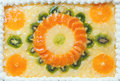 Fruity cake decorated with fruit mosaic on top of orange and kiwi Royalty Free Stock Images