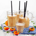 Fruity shakes with fresh fruits selective focus Stock Photos