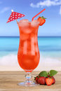 Fruity strawberry fruit cocktail juice drink on the beach Royalty Free Stock Photo