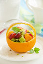 Fruity summer salad in orange Royalty Free Stock Images