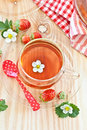 Fruity tea with strawberries in glass cups Royalty Free Stock Images