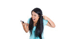 Frustrated angry woman yelling on her phone Royalty Free Stock Photo