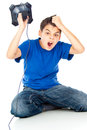 Frustrated boy with a joystick Royalty Free Stock Image