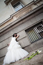 Frustrated bride leaning on wall Royalty Free Stock Image
