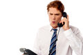 Frustrated business executive shouting angry manager screaming in telephone receiver Stock Image