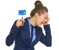 Frustrated business woman cutting credit card Royalty Free Stock Photo