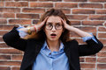 Frustrated business woman holding his hands to her head in frustration. Royalty Free Stock Photo