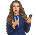 Frustrated business woman pointing on cell phone isolated white Royalty Free Stock Photos