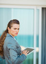 Frustrated business woman using tablet pc young Royalty Free Stock Photos