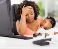 Frustrated businesswoman baby african american with her little in office Royalty Free Stock Images
