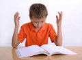 Frustrated child with learning difficulties upset or Royalty Free Stock Photos