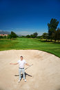 Frustrated golf golfer in sand bunker on course loosing his temper Stock Photo