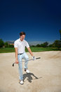 Frustrated golf golfer in sand bunker on course loosing his temper Stock Photography