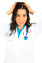 Frustrated healthcare professional closeup portrait of with headache stressed nurse doctor with migraine overworked and Stock Photography