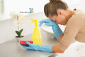 Frustrated housewife in the middle of cleaning work Royalty Free Stock Photo