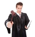 Frustrated Judge With Gavel And Book Royalty Free Stock Photo
