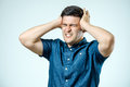 Frustrated man with headache isolated Royalty Free Stock Photo