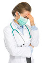 Frustrated medical doctor woman mask isolated white Stock Photos