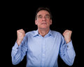 Frustrated middle age business man shaking fists anger black background Royalty Free Stock Photos