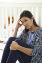Frustrated Mother Suffering From Post Natal Depression Royalty Free Stock Photo
