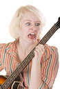 Frustrated music student angry guitar yelling at her instrument Royalty Free Stock Photography