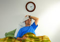 Frustrated stressed out man with insomnia Royalty Free Stock Image