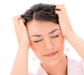 Frustrated woman with a headache portrait isolated over white background Royalty Free Stock Image