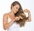 Frustrated woman looking on hair ends isolated white Royalty Free Stock Photography