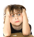 Frustrated young boy portrait of with staring eyes white background Royalty Free Stock Photography