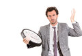 A frustrated young corporate guy with a big clock closeup portrait of anxious businessman executive leader holding stressed and Stock Photo