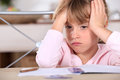 A frustrated young girl doesn t want to do her homework Stock Image