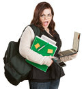 Frustrated young student with backback and laptop Stock Images
