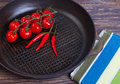 Fry pans and fresh vegetables the Royalty Free Stock Photo