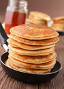 Frying pan with pancakes Royalty Free Stock Photo