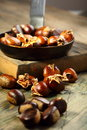 Frying pan and roast chestnuts. Stock Photo